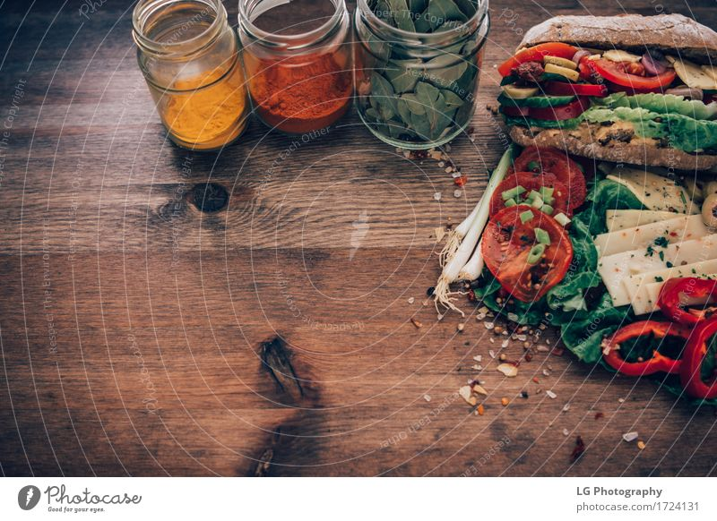 Sandwich on a wooden surface Food Cheese Vegetable Bread Herbs and spices Eating Lunch Vegetarian diet Kitchen Delicious Yellow Green Red Appetite Bay leaf big