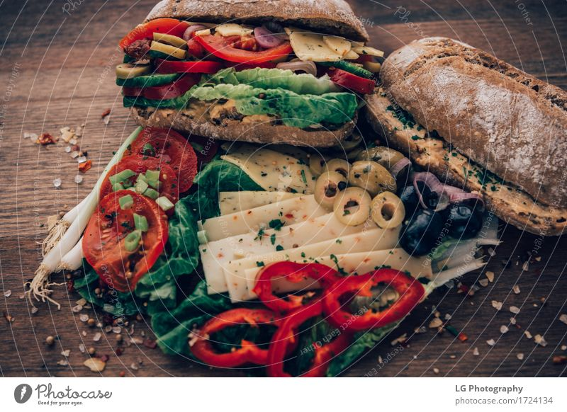 Sandwich on a wooden surface. Food Cheese Vegetable Bread Herbs and spices Eating Lunch Vegetarian diet Kitchen Delicious Yellow Green Red Appetite Bay leaf big