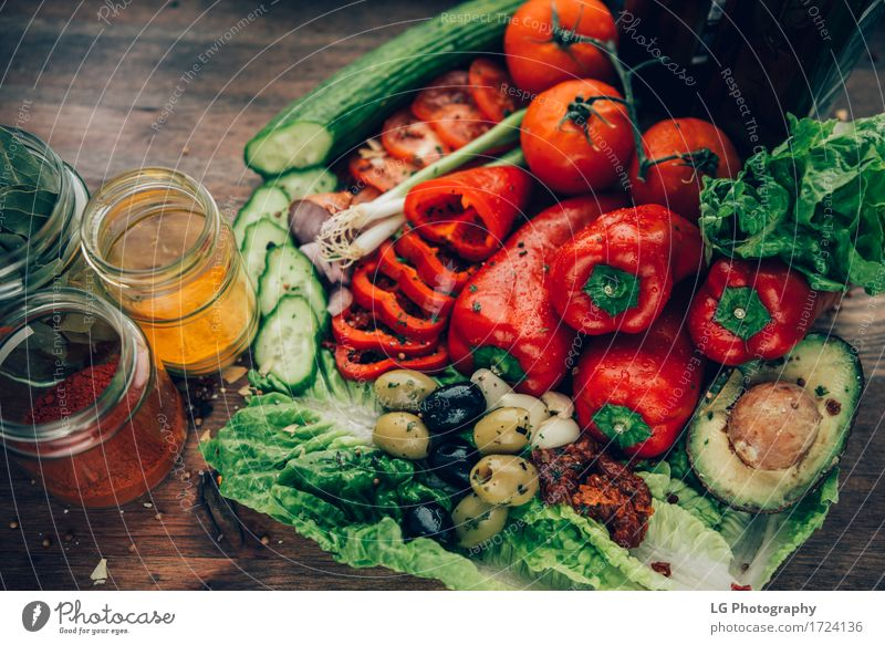 A mix of healthy and colorful produce on a wooden surface. Colour Green Red Leaf Natural Wood Together Bright Fresh Herbs and spices Kitchen Vegetable