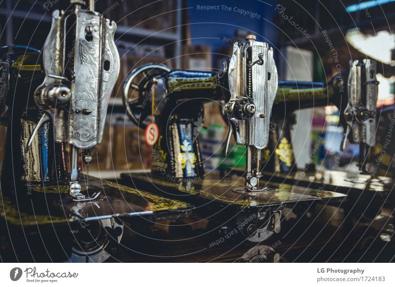 Vintage Sewing Machines Metal Old Services vintage Spool Fashion Industry Fabric thread Tailor Tool Colour photo Close-up Detail Deserted Blur