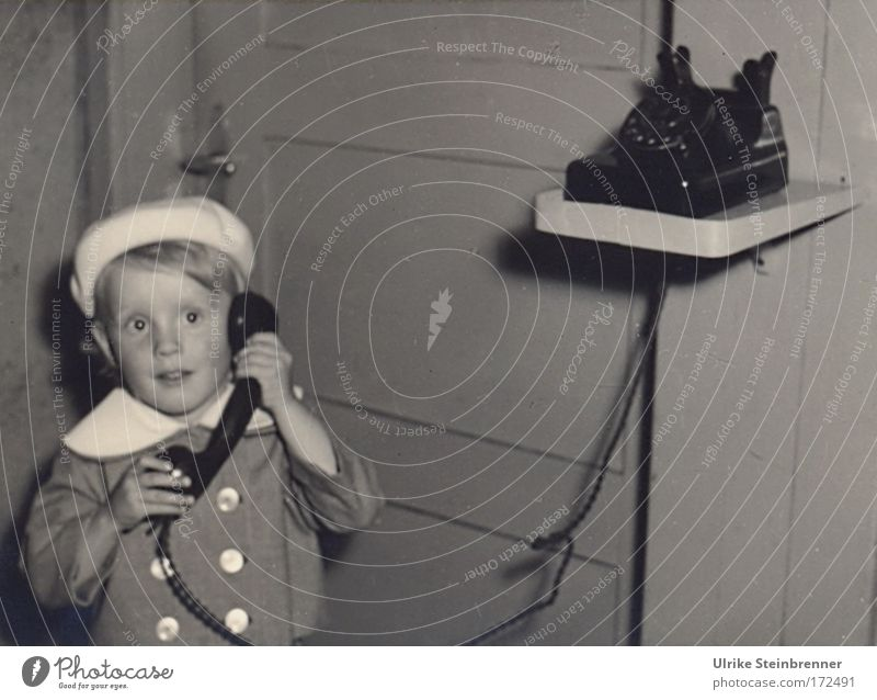 Little girl with beret on the phone Black & white photo Interior shot Copy Space right Flash photo Upper body Front view Forward Face Flat (apartment) Room