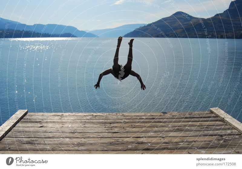 Jump and cool down Colour photo Exterior shot Copy Space left Copy Space right Day Evening Contrast Silhouette Reflection Sunbeam Back-light Deep depth of field