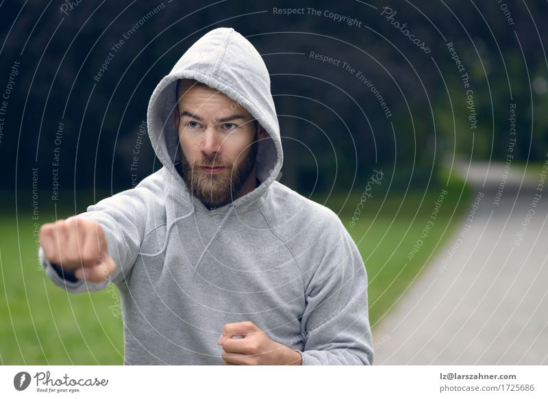 Young man working out in a park Lifestyle Sports Masculine Man Adults 1 Human being 18 - 30 years Youth (Young adults) Park Beard Fitness Action athlete