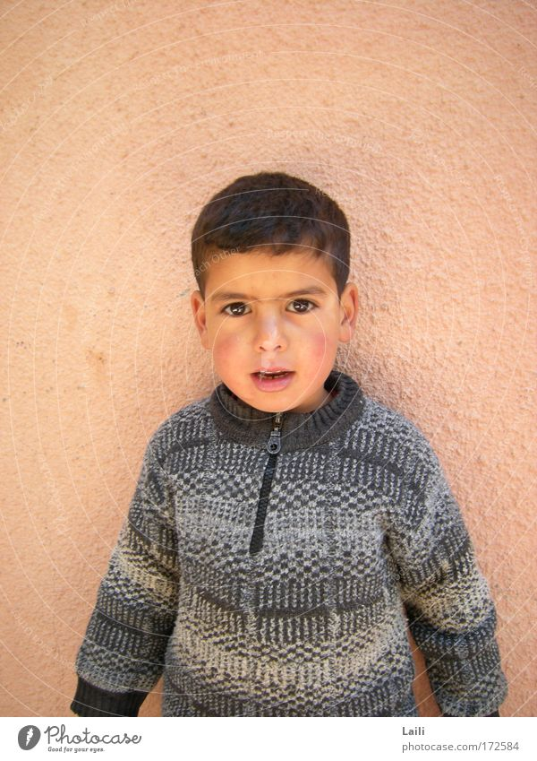 Berber boy Colour photo Exterior shot Copy Space left Copy Space right Morning Central perspective Portrait photograph Looking Looking into the camera