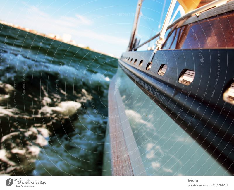 Sailing in a sailing boat with wooden superstructure with waves hard on the wind the sea foams Sailboat Yacht Sailing ship Vacation & Travel Adventure Freedom