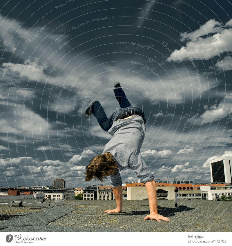 Human being Sky Man Hand City Joy Clouds House (Residential Structure) Adults Environment Wall (building) Hair and hairstyles Wall (barrier) Dance Arm