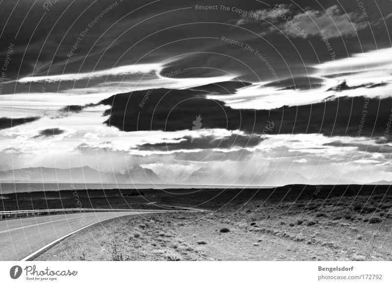 Summer Far-off places Freedom Black & white photo Highway Nature Storm Elements Copy Space Steppe Dramatic Sublime Roadside Sparse Storm clouds