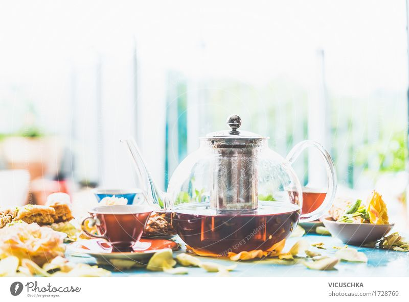 Drinking tea on the table at the window Cake Dessert Candy Buffet Brunch Beverage Hot drink Tea Crockery Cup Glass Lifestyle Style Design Living or residing