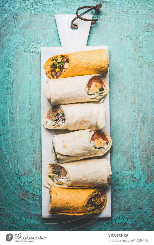 Vegetarian delicious tortilla wraps on cutting board Food Fish Vegetable Lettuce Salad Bread Herbs and spices Nutrition Lunch Dinner Buffet Brunch Banquet