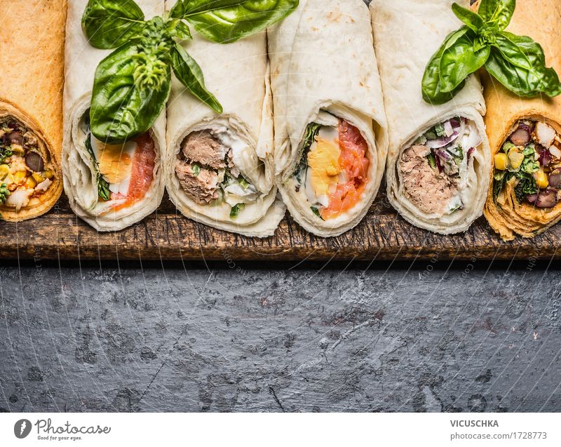 Delicious tortilla wraps on a dark background Food Fish Vegetable Bread Nutrition Lunch Buffet Brunch Picnic Organic produce Vegetarian diet Diet Style Design
