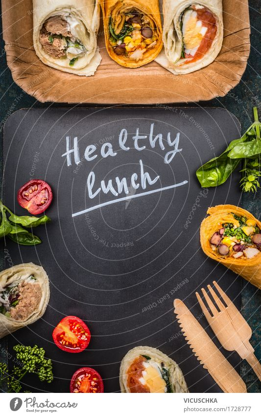 Healthy lunch with vegetarian wraps Food Fish Vegetable Bread Nutrition Lunch Banquet Organic produce Vegetarian diet Diet Cutlery Knives Fork Style Design