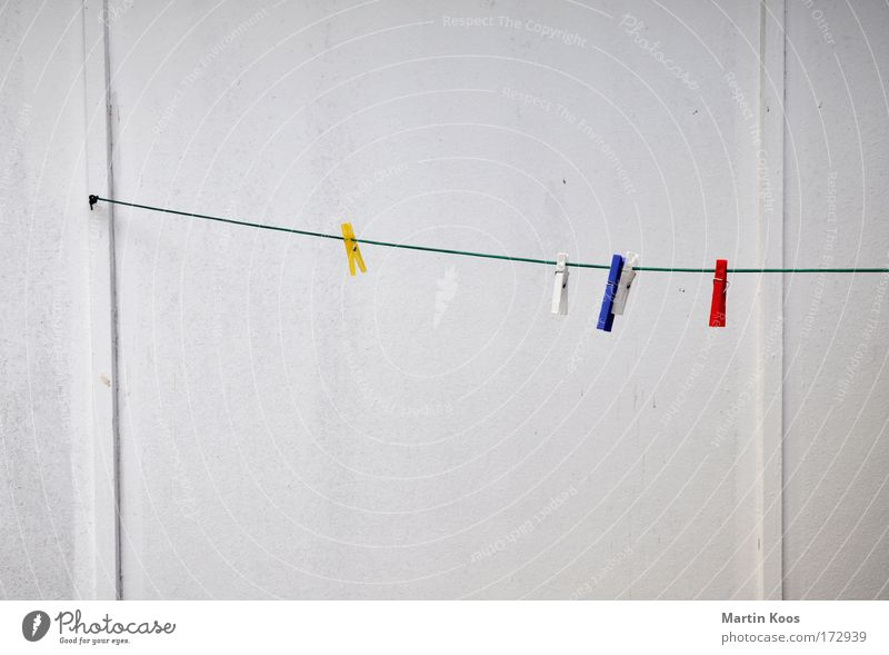 arid Wall (building) Clothesline Wooden wall Holder Rope Hang Dirty Clean Gloomy Dry Blue Yellow Red White Diligent Orderliness Boredom boringly Household