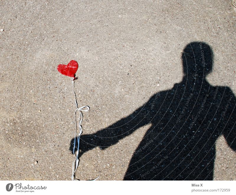 the air is out Flirt Woman Adults Partner 1 Human being Street Lanes & trails Balloon Together Love Loyalty Romance Sadness Lovesickness Disappointment