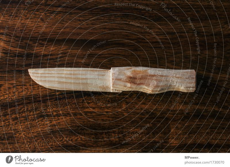 wood knife Wood Sign Fight Aggression Anger Embitterment Revenge Force Hatred Knives Sharp thing Graven Wood grain Toys Perpetrator Weapon Brown Colour photo