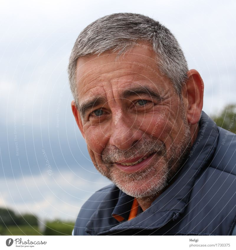 friendly senior with grey hair and grey beard smiles into the camera Human being Masculine Man Adults Male senior Senior citizen Head Face Facial hair 1