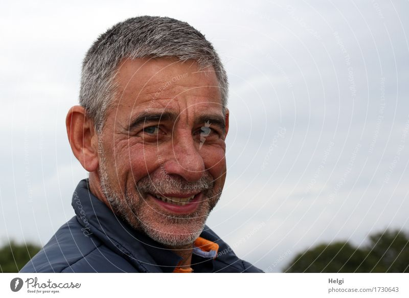 Portrait of a smiling senior with grey hair and grey beard in front of a grey sky Human being Masculine Man Adults Male senior Senior citizen Head Face