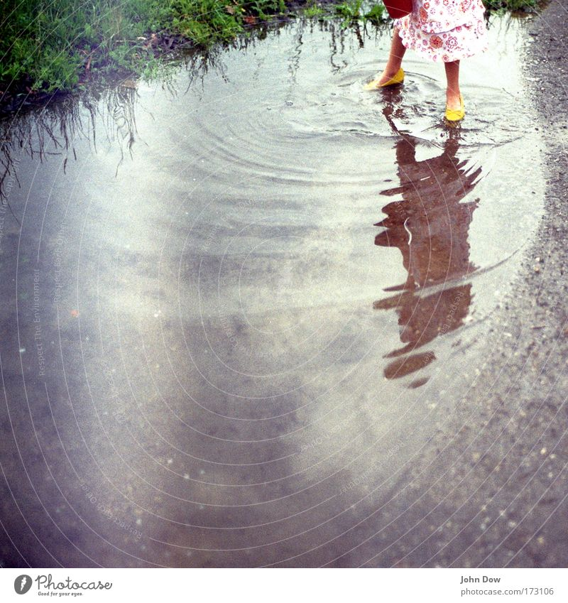 Human being Nature Water Girl Joy Yellow Meadow Playing Grass Movement Child Footwear Reflection Memory Leisure and hobbies