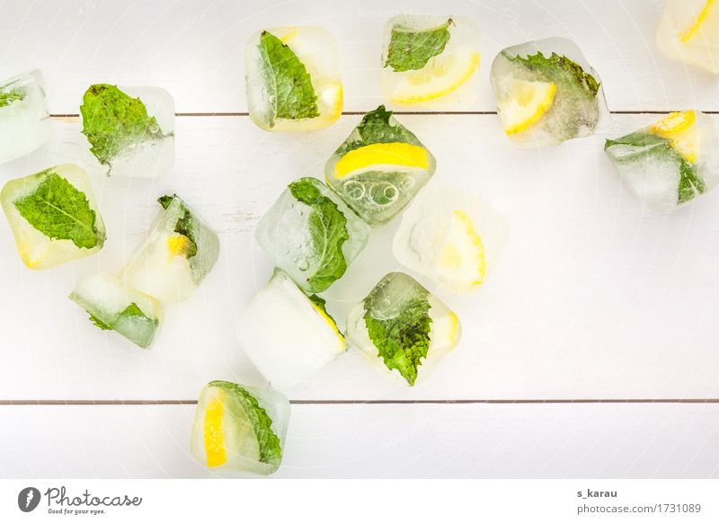 Summer ice cubes Background picture Copy Space Ice Ice cube Mint Lemon Yellow Green Leaf Seasons Cold Cooling Refreshment Warmth Beverage Fresh Sense of taste