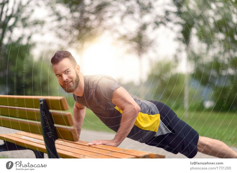 Young man doing push-ups in a park Human being Youth (Young adults) Man 18 - 30 years Face Adults Sports Lifestyle Masculine Park Copy Space Body Action Fitness Bench Musculature