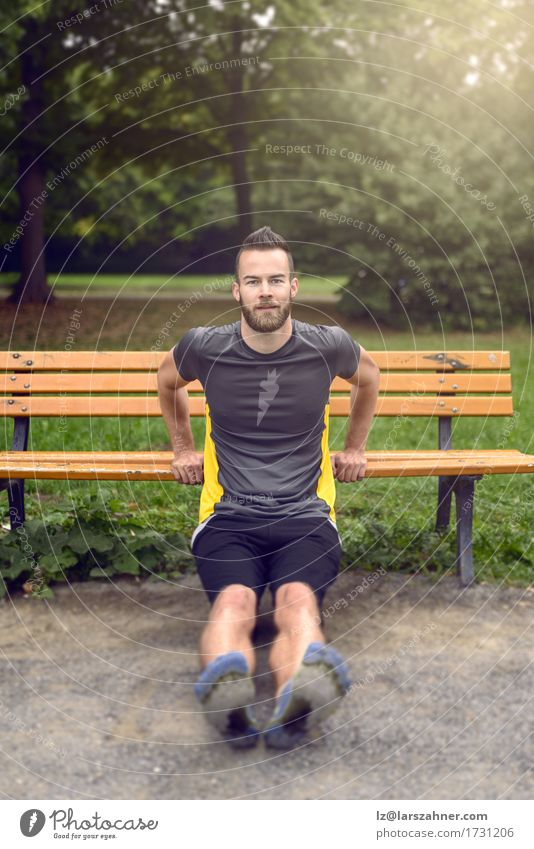 Young man exercising in a park Lifestyle Body Face Sports Man Adults 1 Human being 18 - 30 years Youth (Young adults) Nature Park Beard Wood Fitness Athletic