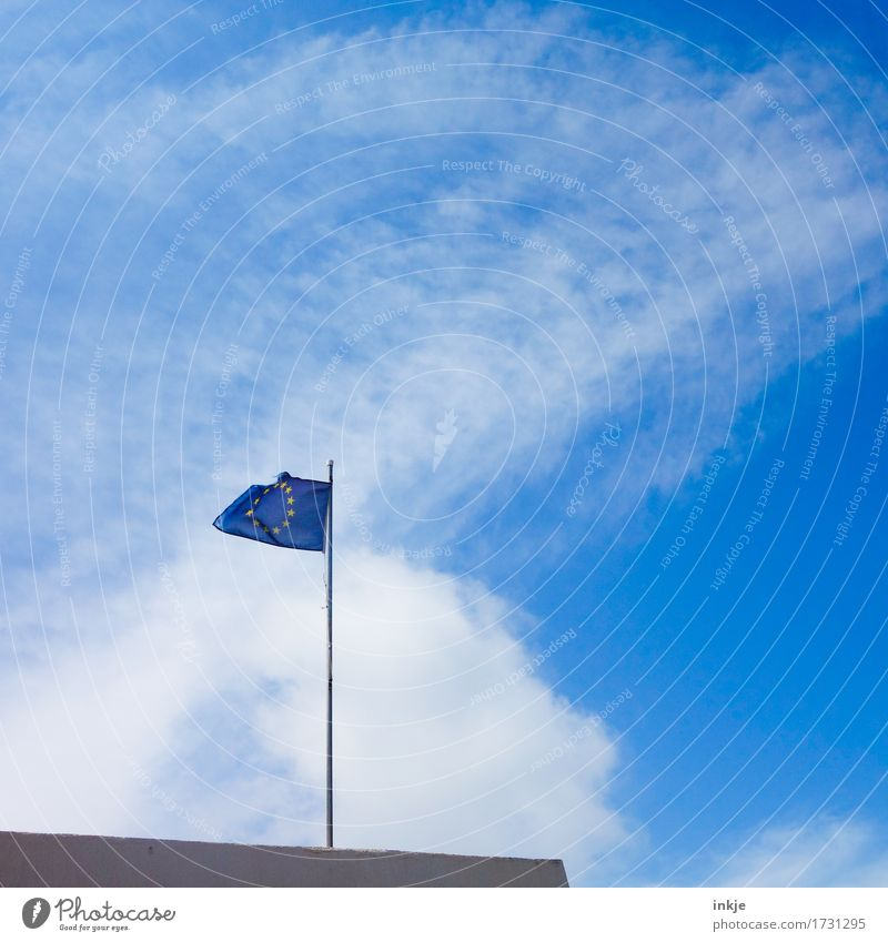 Hard on the wind Sky Summer Beautiful weather Wind Sign Network Flag European flag Europe emblem Blue Fear of the future Society Crisis Might Politics and state