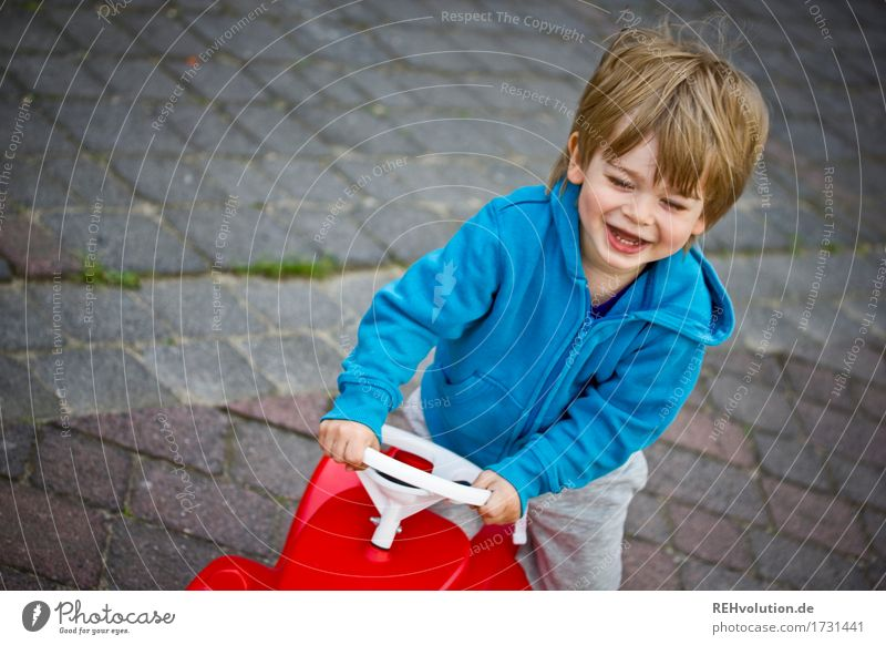 Human being Child Blue Red Joy Funny Movement Boy (child) Playing Laughter Happy Small Masculine Car Infancy Happiness