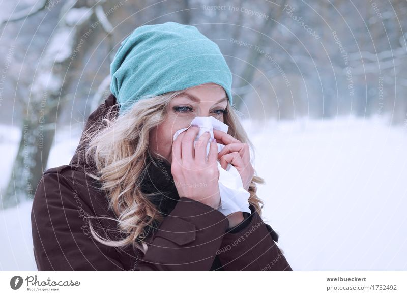 woman blowing her nose in winter Human being Woman Nature Youth (Young adults) Young woman Winter Forest Adults Cold Lifestyle Snow Feminine Healthy Park
