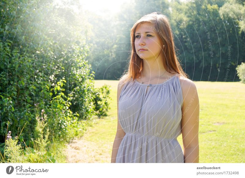 young woman in a park with sun flare Human being Woman Nature Youth (Young adults) Summer Young woman Sun Landscape 18 - 30 years Adults Lifestyle Feminine Garden Think Park Copy Space