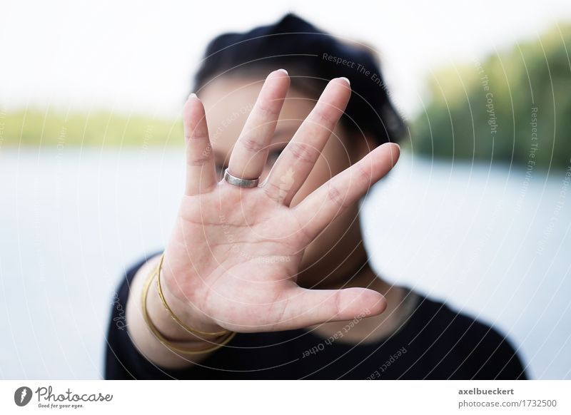 woman hiding face behind hand Lifestyle Human being Young woman Youth (Young adults) Woman Adults Hand 1 18 - 30 years Protection Fear Identity Gesture shy