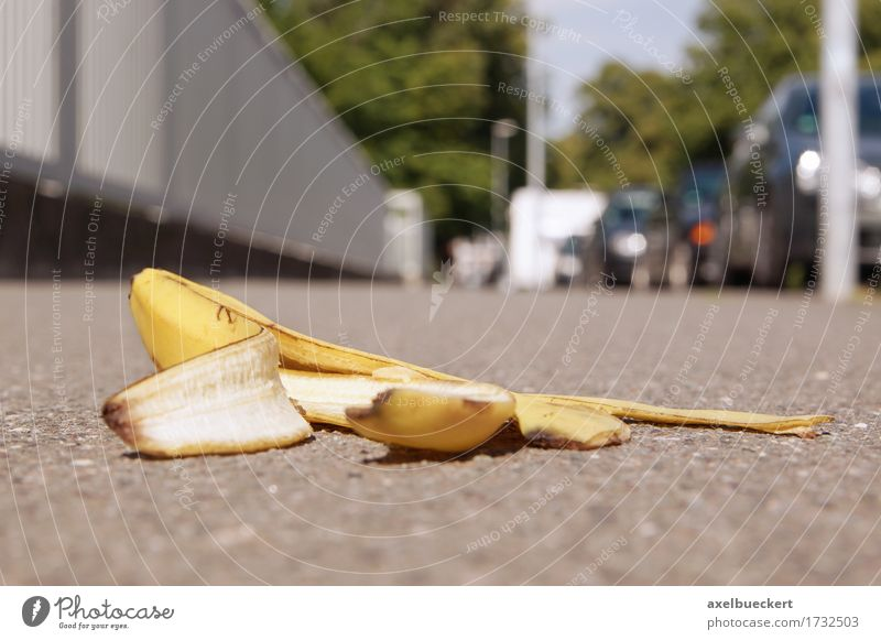 discarded banana skin on pavement Town Pedestrian Street Caution Insurance Banana banana peel Sidewalk Footpath Ground Discarded Copy Space Accident Risk