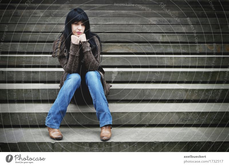 lonely woman sitting on steps Lifestyle Human being Young woman Youth (Young adults) Woman Adults 1 18 - 30 years Stairs Jeans Black-haired Long-haired Stone