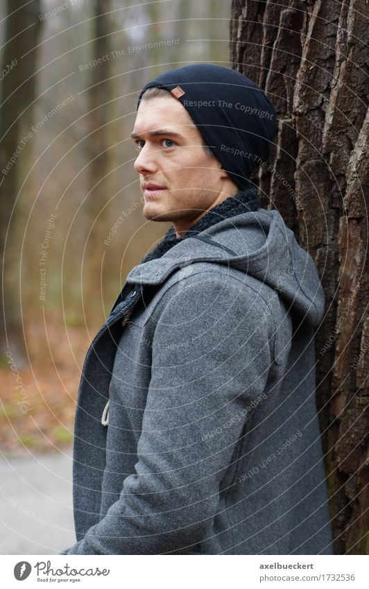 lonely man leaning against a tree Lifestyle Winter Human being Masculine Young man Youth (Young adults) Man Adults 1 18 - 30 years Autumn Tree Forest Jacket