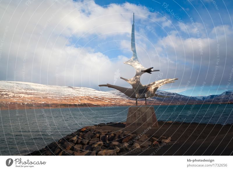 Sculpture at the harbour of Akureyri Vacation & Travel Sightseeing City trip Town Tourist Attraction Iceland landmark vicings sculpture mountains Icelandic