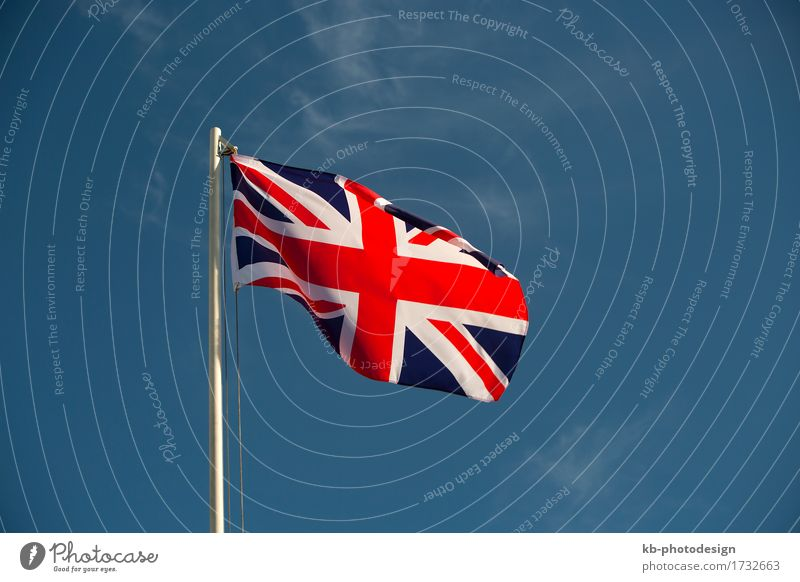 Great Britain flag in front of a blue sky Vacation & Travel Business Wind Sign Flag United Kingdom British English Iceland isle Europe queen Union Jack nation