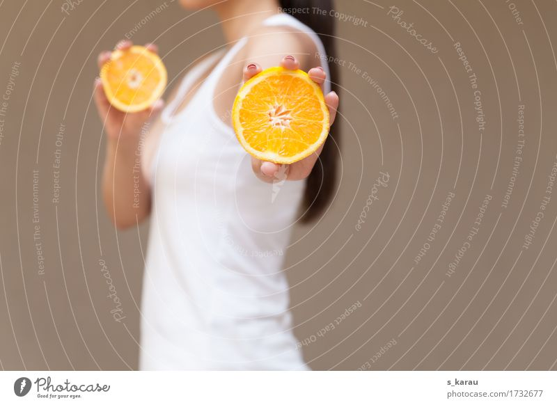 Human being Eating Sports Feminine Healthy Food Hair and hairstyles Orange Fruit Fresh Nutrition Body Power Orange Happiness Fitness
