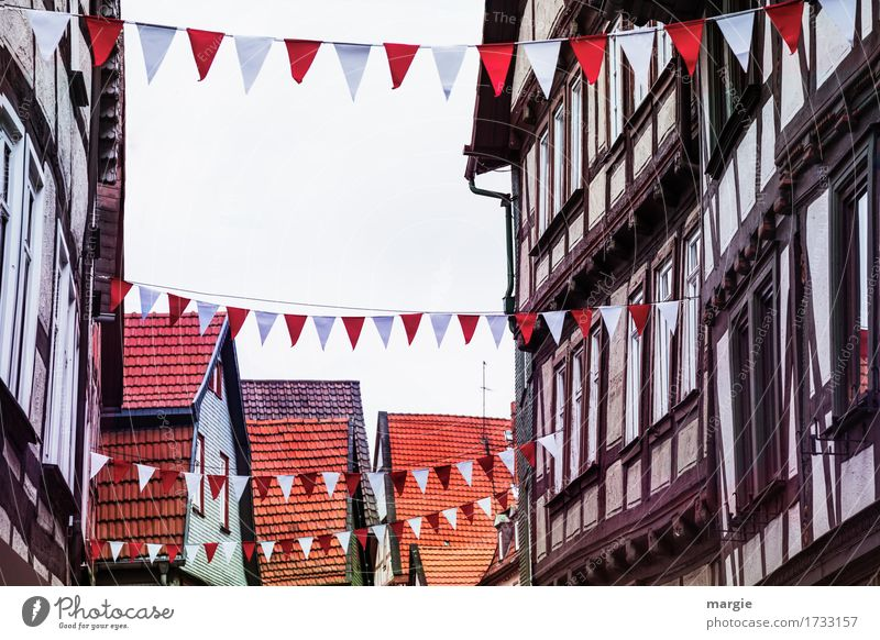AST 9 | Today we celebrate! Half-timbered houses decorated with white red flags Village Small Town Downtown Old town Pedestrian precinct