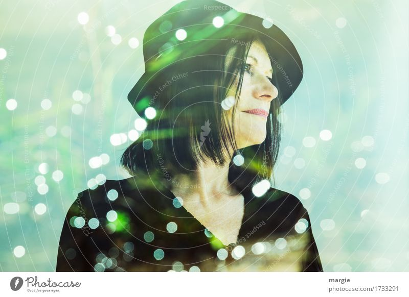 Lady in green, a young woman with hat surrounded by many lights Snow Human being Feminine Woman Adults 1 Hat Green Black Belief Dream Homesickness Wanderlust