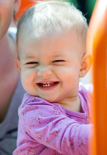 Beautiful little baby smiling with teeth showing outdoors Joy Happy Summer Sun Child Baby Girl Infancy Teeth 1 Human being 1 - 3 years Toddler Park Places