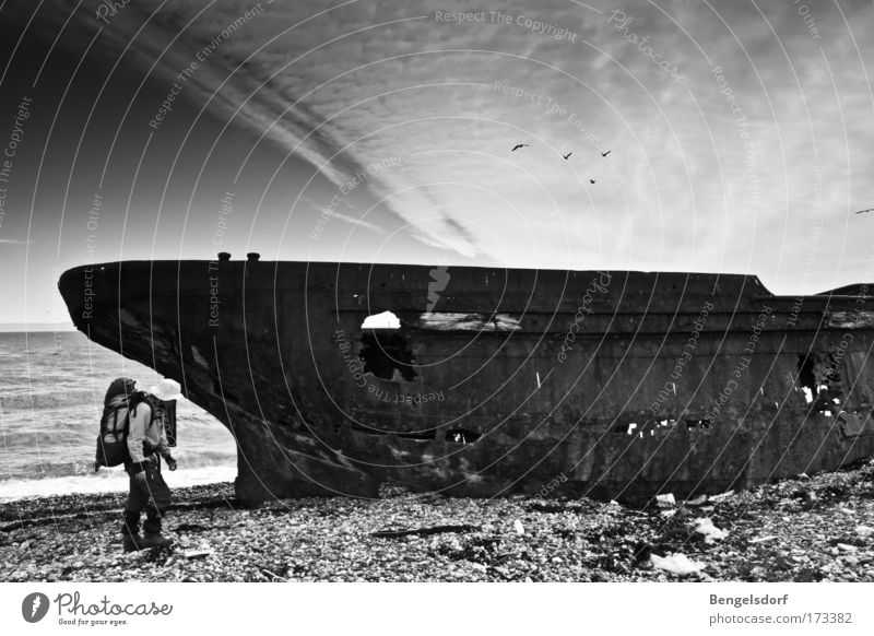 ghost ship Vacation & Travel Trip Adventure Expedition Summer Ocean Human being 1 Wreck Discover Decline Past Transience Gravel Cloud cover Black & white photo