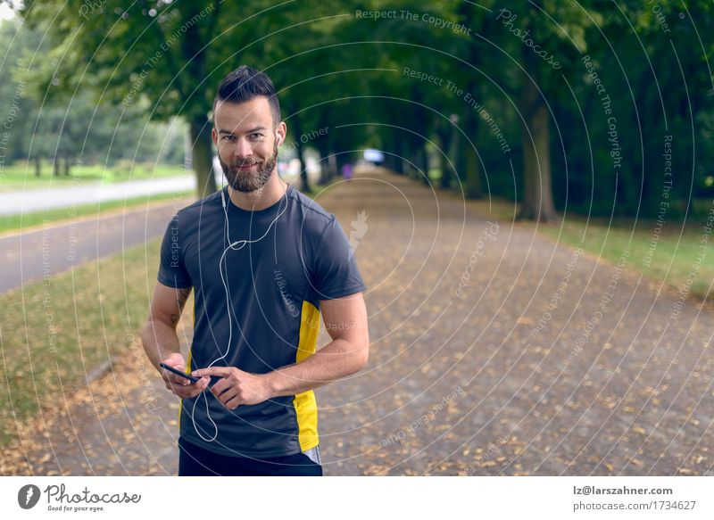 Attractive bearded man listening to music Human being Youth (Young adults) Man Summer 18 - 30 years Face Adults Sports Lifestyle Park Music Smiling Fitness