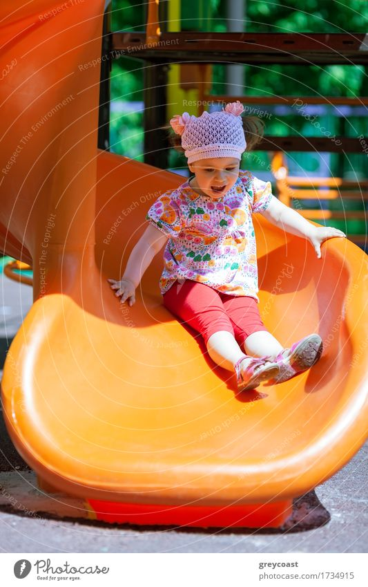 Small girl having fun on a slide Human being Child Summer Sun Joy Girl Playing Action Infancy Cute Plastic Toddler Vertical Playground Lovely