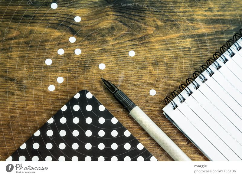 Collect points: black paper with white dots, fountain pen, and spiral pad with writing lines Study Professional training Office work Workplace
