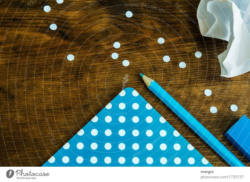 collect points: blue paper with white dots, pencil, eraser and a crumpled piece of paper on a wooden desk School Study Work and employment Profession