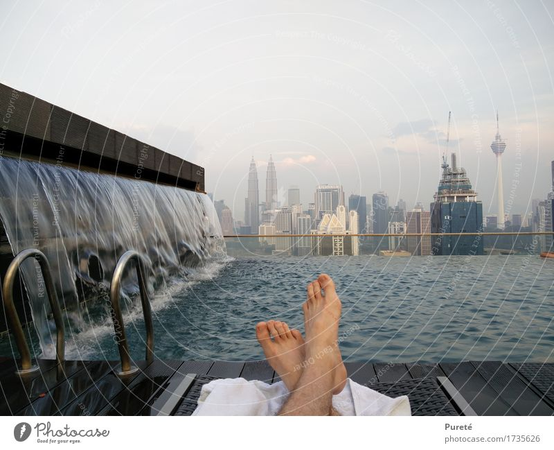 Far away from trouble Relaxation Leisure and hobbies Swimming & Bathing Swimming pool Warmth Waterfall Kuala Lumpur Malaya Asia Town Capital city Skyline