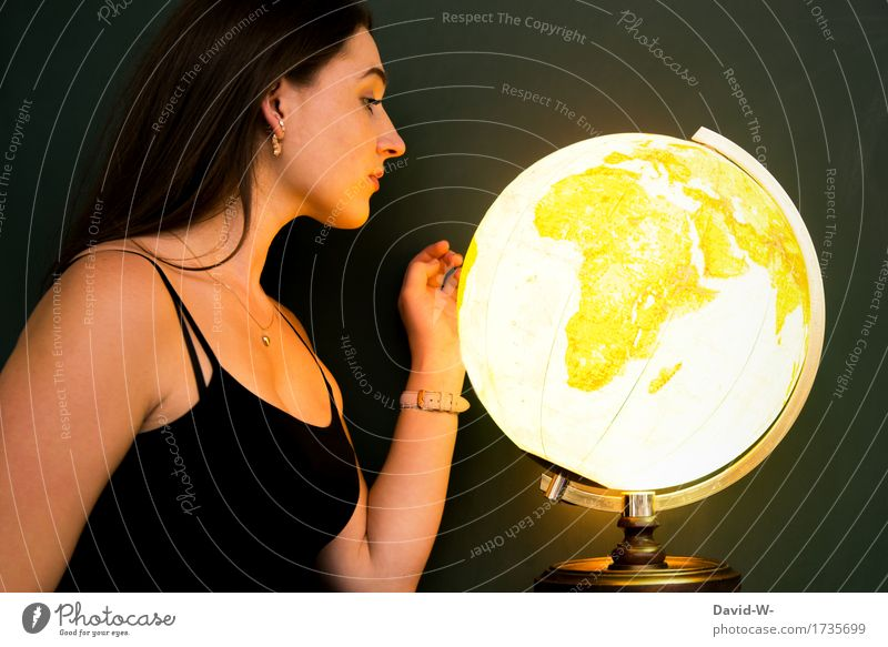 young woman with a shining globe Globe Global world Around-the-world trip contemplating look at luminescent Illuminate golden Young woman youthful pretty