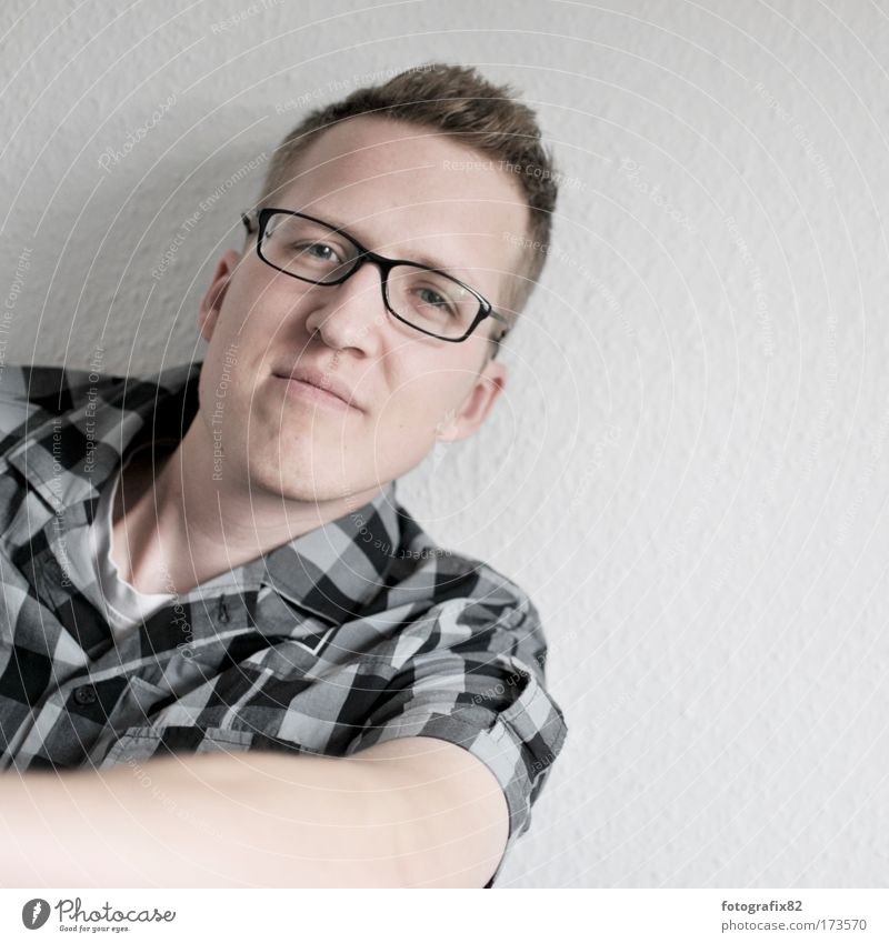 Human being Man Portrait photograph Youth (Young adults) Face Wall (building) Adults Arm Flat (apartment) Masculine Eyeglasses Shirt Looking Smiling Checkered Lean