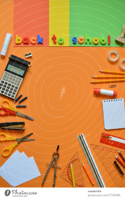 Back to school - school utensils on orange background with the words BACK TO SCHOOL Education School Study Homework Workplace Stationery Paper Piece of paper