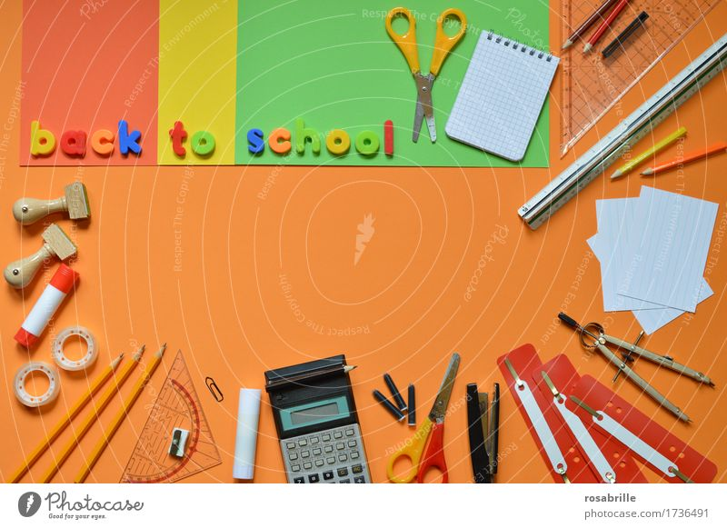 Start of school - colourful school utensils on an orange background with the words BACK TO SCHOOL Education School Study Homework Workplace Stationery Paper