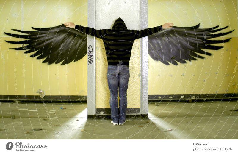 Human being Adults Wall (building) Graffiti Freedom Wall (barrier) Fashion Bird Fear Back Elegant Flying Masculine Aviation Angel Jeans