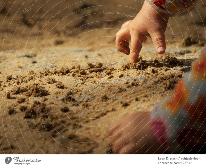 Human being Hand Girl Yellow Emotions Happy Gray Sand Contentment Moody Brown Arm Child Earth Cute Painting (action, artwork)